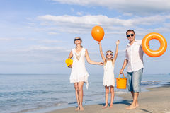 Happy family walking on the beach at the day time. Royalty Free Stock Image