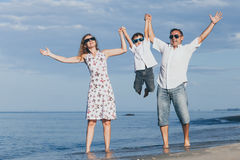 Happy family walking on the beach at the day time. Royalty Free Stock Photo