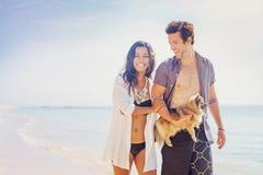 Happy family walking on a beach Royalty Free Stock Photo