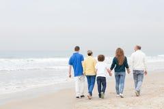 Happy family walking on beach Royalty Free Stock Photos