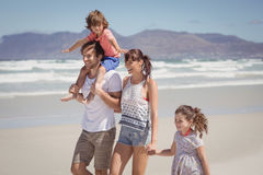 Happy family walking at beach Royalty Free Stock Images