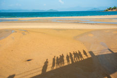 Happy family walking on the beach Royalty Free Stock Image