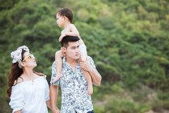 Happy family walking on the beach together Stock Photo