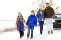 Happy family walking in countryside. On winter day Stock Photo