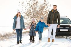 Happy family walking in countryside. On winter day Royalty Free Stock Images