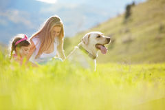 Happy family walking with dog Stock Photo