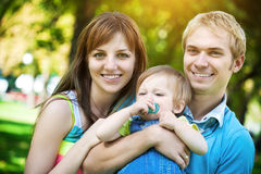 Happy family walking in the green summer park Royalty Free Stock Photos