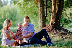 Happy family are walking in the green summer park. Picnic Stock Image