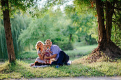 Happy family are walking in the green summer park Royalty Free Stock Images