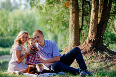 Happy family are walking in the green summer park. Picnic Royalty Free Stock Photos