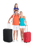 Happy family walking with luggage on white background. Stock Photography