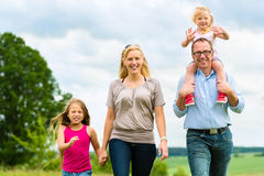 Happy Family walking in the meadow Stock Images
