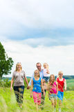 Happy Family walking in the meadow Royalty Free Stock Image