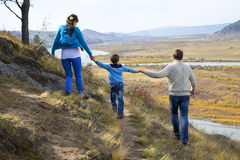 Happy family walking in the mountains Stock Photography