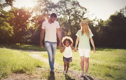 Happy family walking in nature with child royalty free stock images