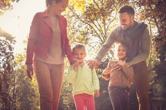 Happy family walking nature. On the move. Happy family walking nature. Smiling happy family in park together Stock Photo