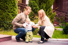 Happy family walking outdoor. Happy family walking with a baby outdoor Royalty Free Stock Photography