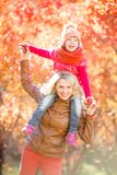 Happy family walking outdoor in fall Royalty Free Stock Images