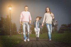 Happy family walking outdoors Stock Photos