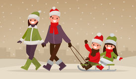 Happy family walking outdoors in winter. Parents  are carry chil Stock Images