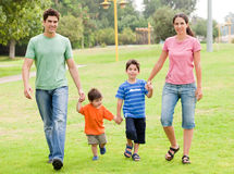 Happy family walking in the park Stock Photo