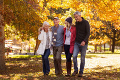 Happy family walking at park. During autumn Stock Image