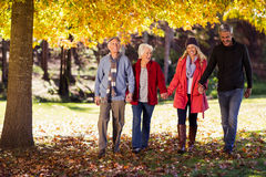 Happy family walking at park. During autumn Stock Photography