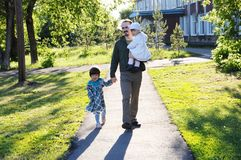 Happy family walking in park. father with daughters at sunny day. dad and girls. Bonding relationship Stock Photography