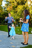 Happy family walking in park Stock Photography
