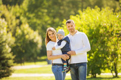 Happy family walking in Park Stock Photo
