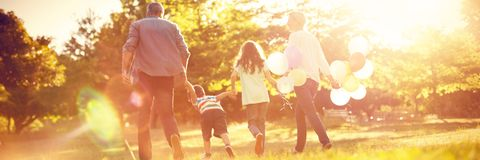 Happy family walking at park royalty free stock image