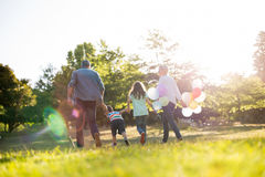 Happy family walking at the park Royalty Free Stock Images