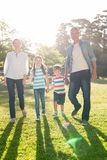 Happy family walking at the park. On a sunny day Stock Image