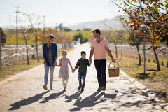 Happy family walking in the park Stock Photos