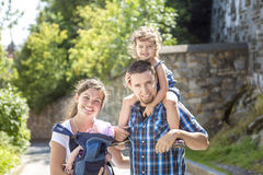 Happy family walking through park on vacation day Royalty Free Stock Photos