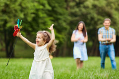 Happy family walking playing in the park.  Royalty Free Stock Photos