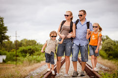 Happy family walking on the railway at the day time. Stock Images