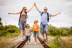 Happy family walking on the railway at the day time. Royalty Free Stock Image