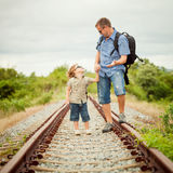 Happy family walking on the railway at the day time. Royalty Free Stock Photos