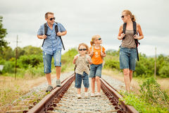 Happy family walking on the railway at the day time. Stock Photography