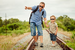 Happy family walking on the railway at the day time. Royalty Free Stock Photo