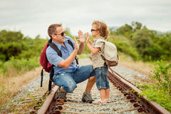 Happy family walking on the railway at the day time. Concept of friendly family Stock Image