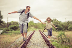 Happy family walking on the railway at the day time. Concept of friendly family Stock Photos