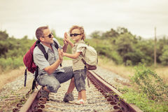 Happy family walking on the railway at the day time. Concept of friendly family Royalty Free Stock Image