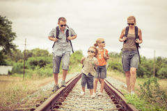 Happy family walking on the railway at the day time. Concept of friendly family Royalty Free Stock Photography