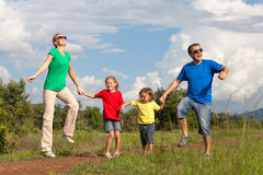 Happy family walking on the road at the day time Stock Image