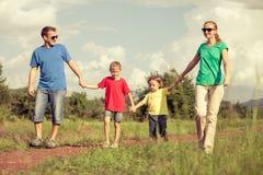 Happy family walking on the road Stock Photo