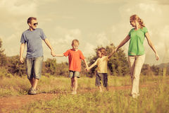 Happy family walking on the road Stock Image