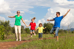 Happy family walking on the road at the day time. Concept of friendly family Stock Image