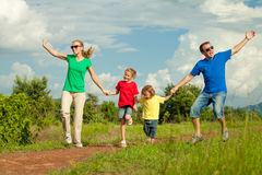 Happy family walking on the road Royalty Free Stock Photos
